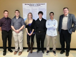 GEOG 3000 students with FASS Dean Osborne at poster presentation