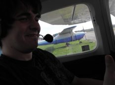 Alex F ready for takeoff. It was a small plane, but somehow it seemed smaller from the backseat…